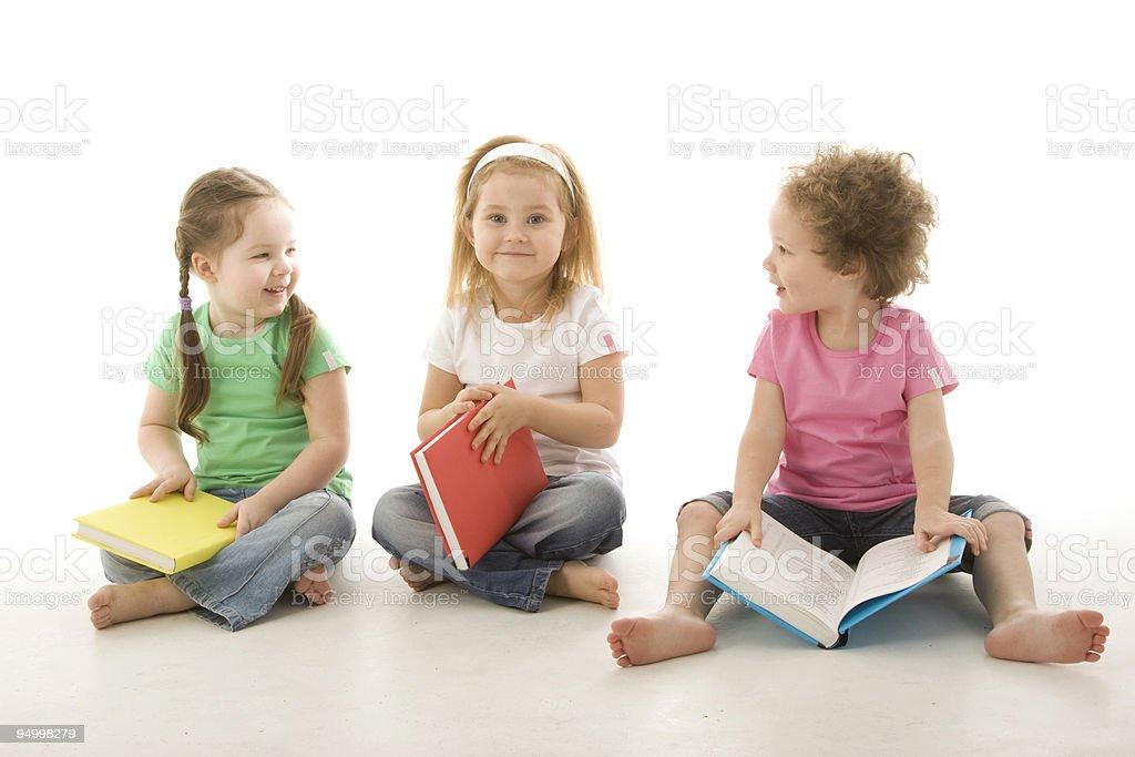 Little girls reading books royalty-free stock photo