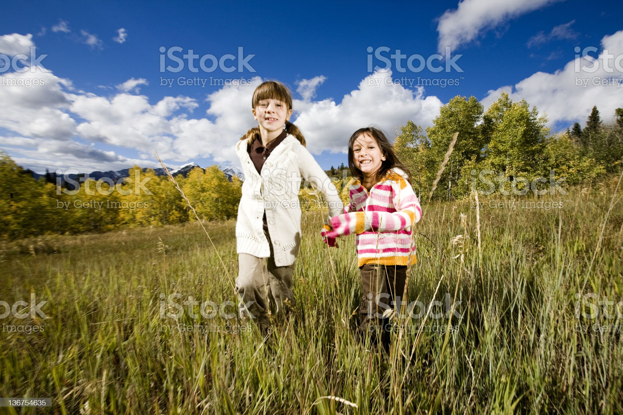 Little Girls Running in the Mountains royalty-free stock photo