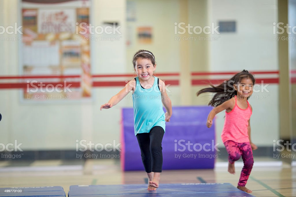 Little Girls Running on Gymnastics Mats stock photo
