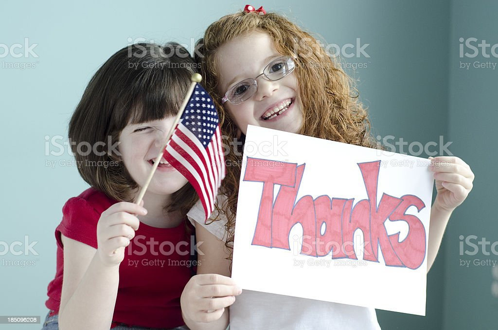 Little girls say thanks to the American armed forces royalty-free stock photo