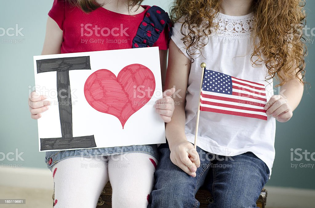 little girls show that they love the USA royalty-free stock photo