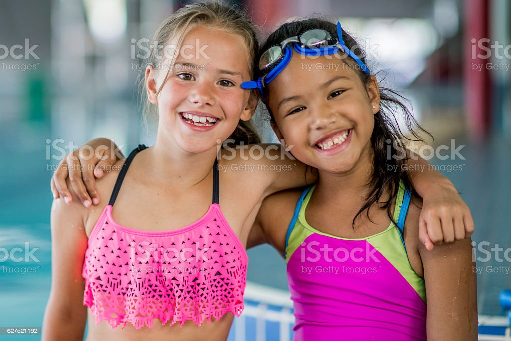 Little Girls Swimming at the Pool stock photo