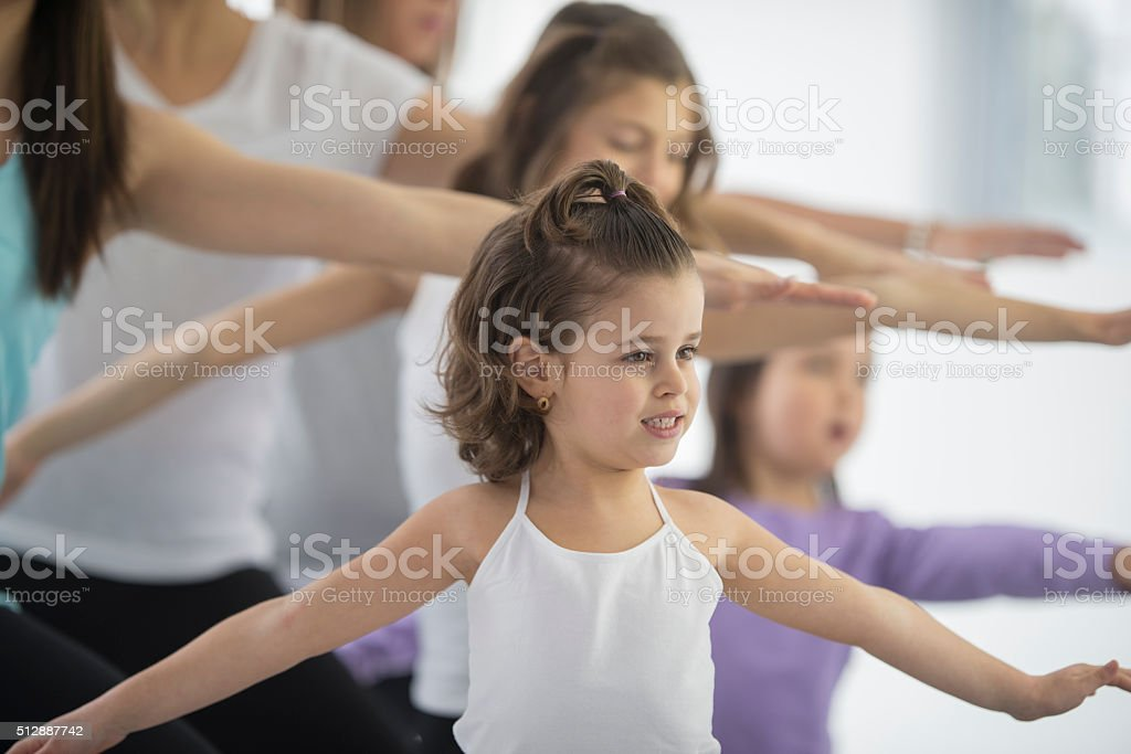 Little Girls Taking a Yoga Class with Their Moms stock photo