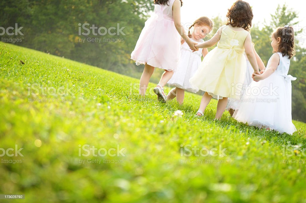 Little Girls Wearing Dresses and Spinning in a Circle royalty-free stock photo