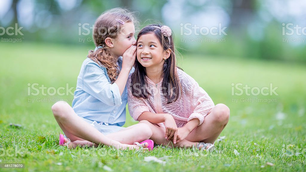 Little Girls Whispering stock photo