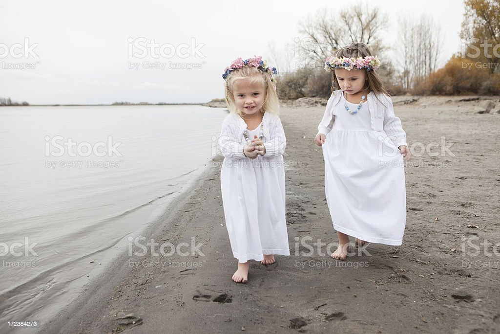 Little Girls with Flowers in Hair on Beach royalty-free stock photo