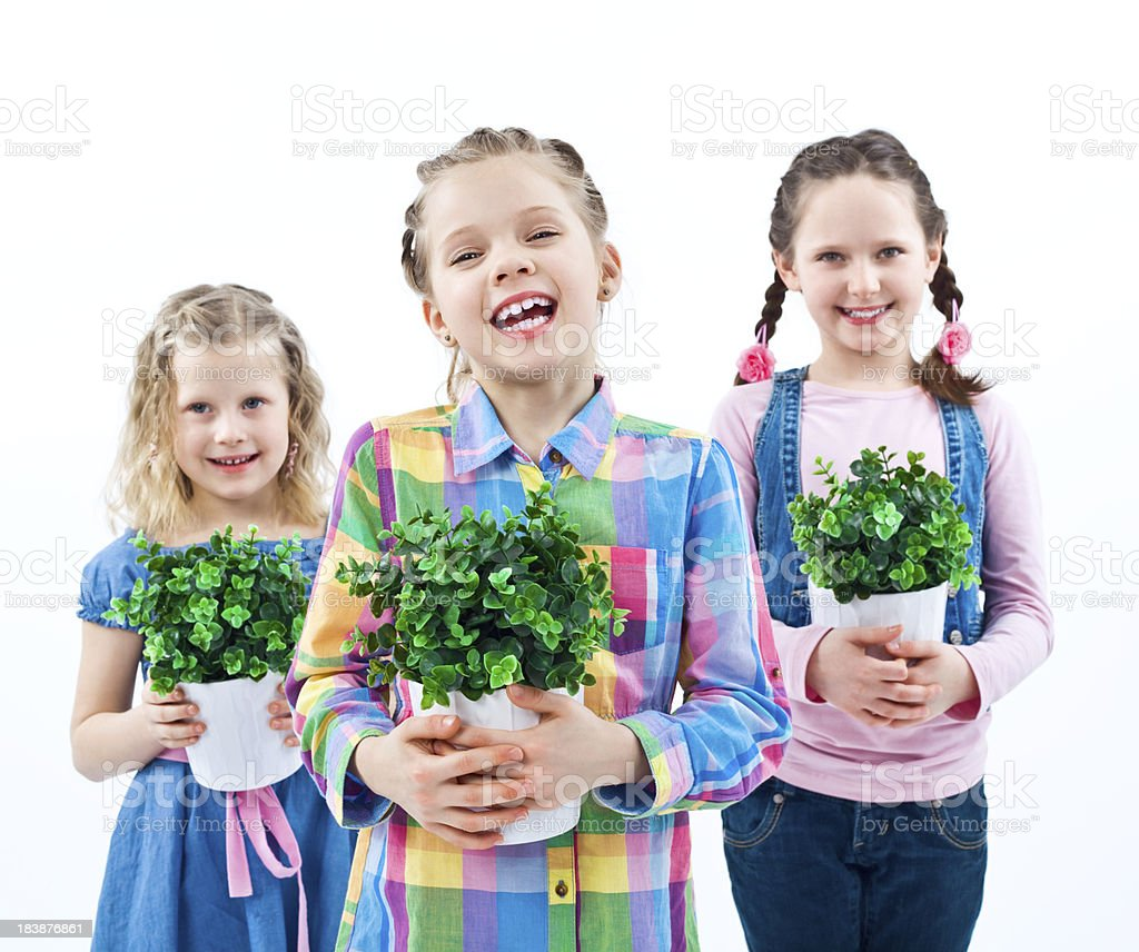 Little girls with potted plants royalty-free stock photo