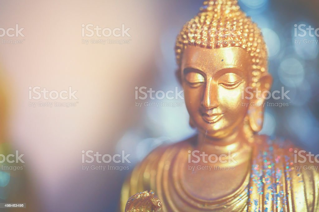 Little golden Buddha stock photo