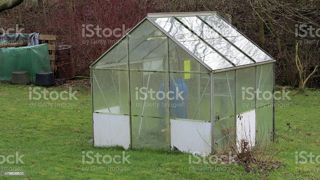 Little greenhouse in a garden stock photo