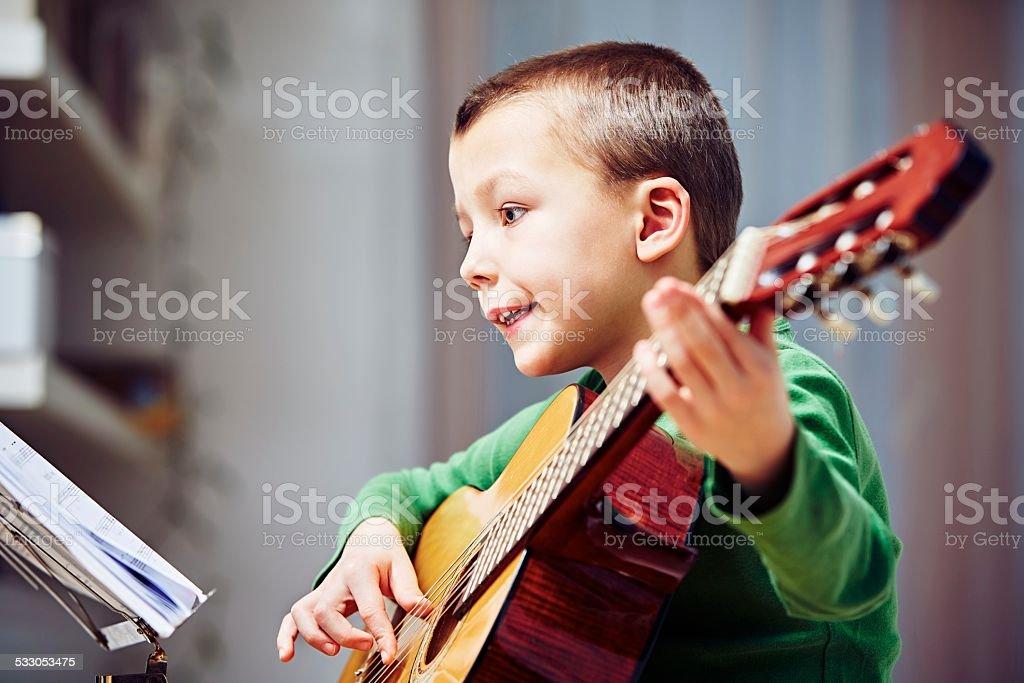 Little guitarist stock photo