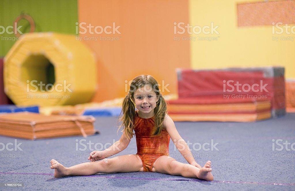 Little Gymnast Doing a Straddle Split royalty-free stock photo