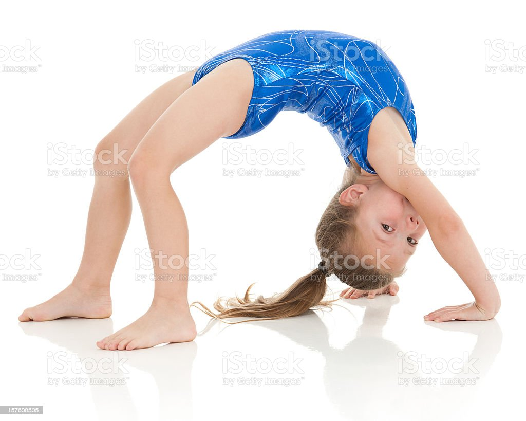 Little gymnast doing in a bridge exercise, eyes on viewer stock photo