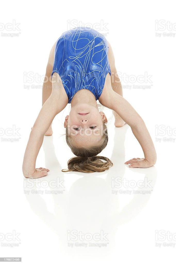 Little gymnast doing in a bridge with reflection stock photo