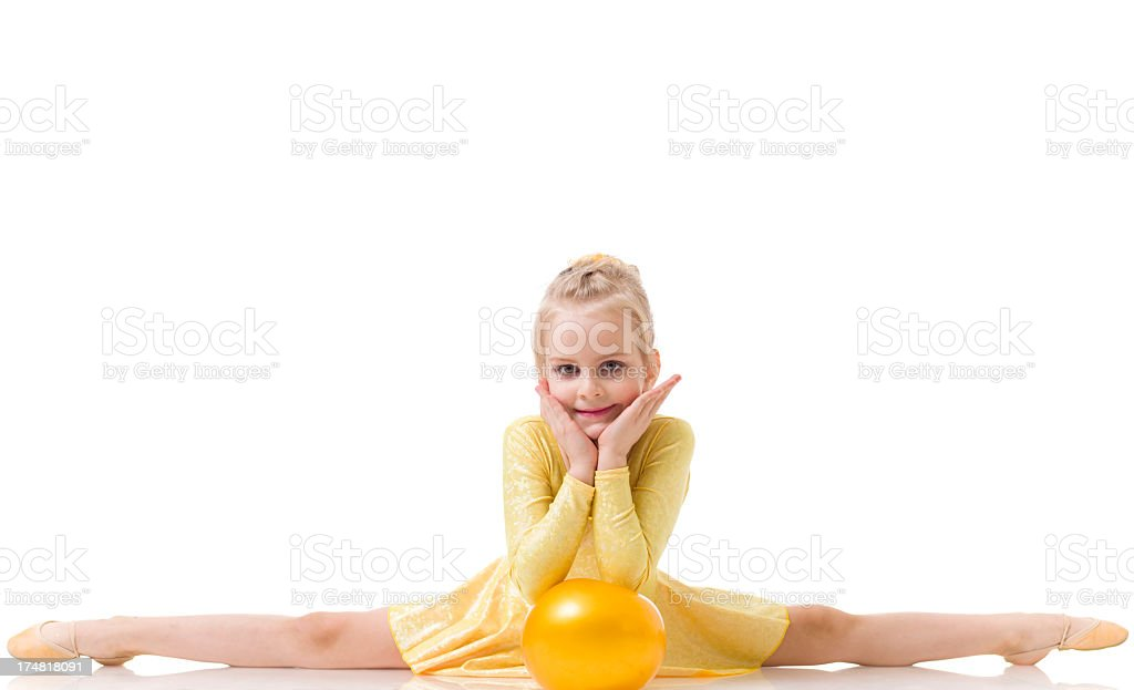 Little Gymnast girl Doing Split isolated on white stock photo