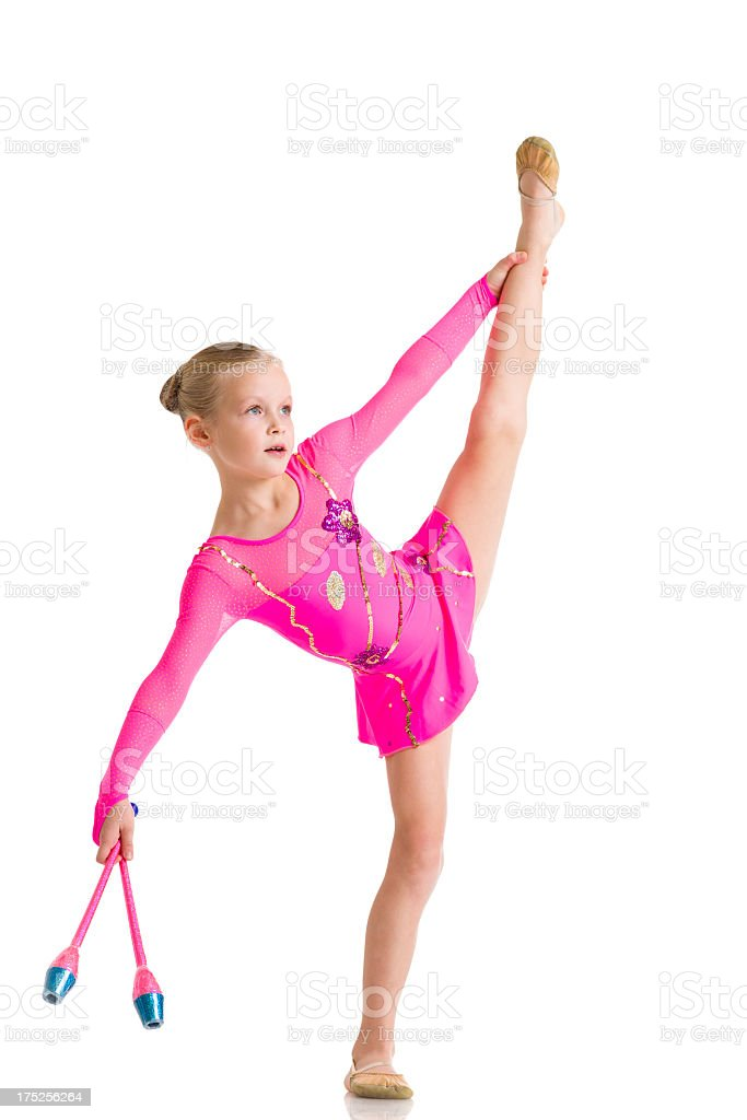 Little Gymnast girl with Rhythmic Gymnastics clubs isolated on white royalty-free stock photo