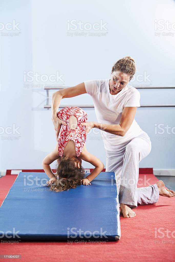 Little gymnast with coach royalty-free stock photo