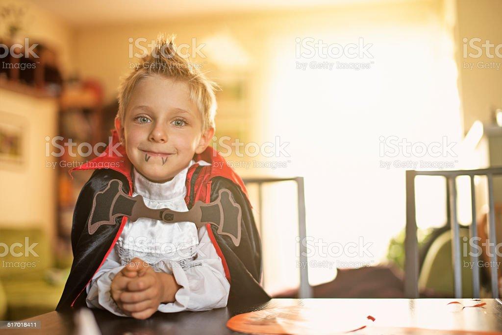 Little halloween vampire boy stock photo
