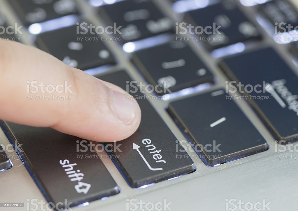 little hand and enter keyboard stock photo