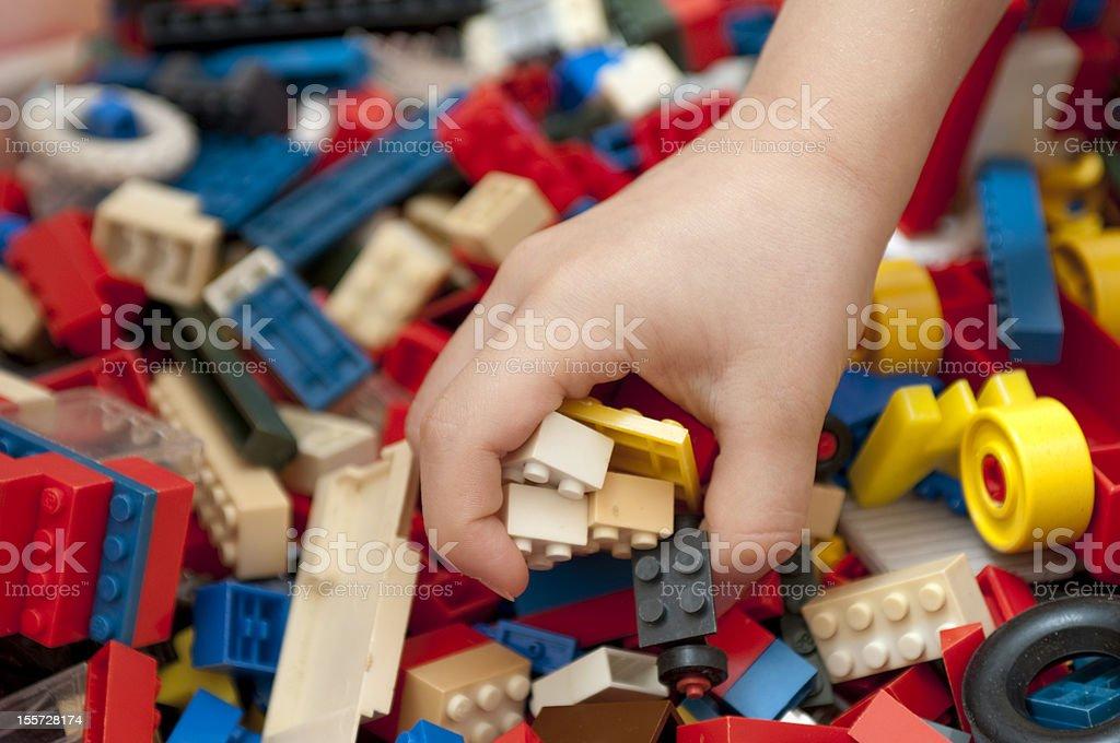 little hand catch bricks stock photo