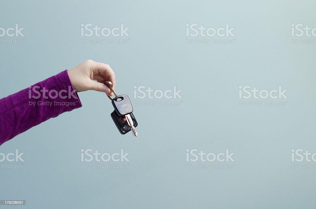 LIttle hand holds a set of car keys stock photo