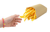 Little hand taking French fries isolated on white.