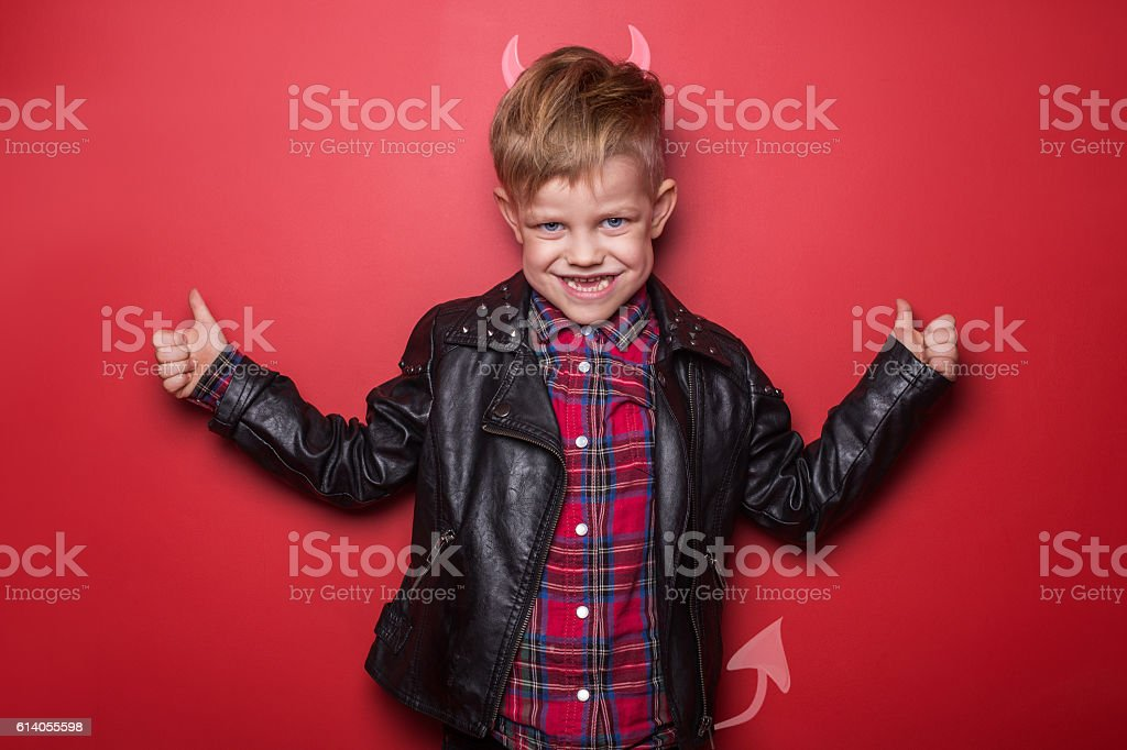 Little handsome devil with horns and tail. Kid. Halloween stock photo