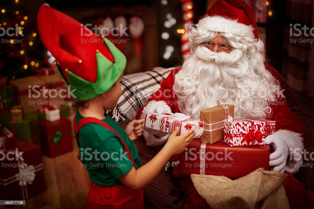 Little helper of St. claus at the work stock photo