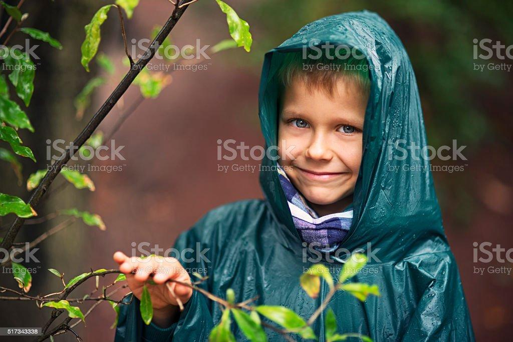 Little hiker in the rain stock photo