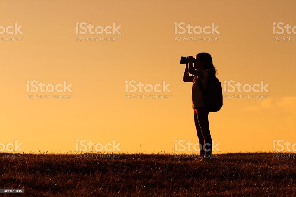 Little hiker with binoculars stock photo