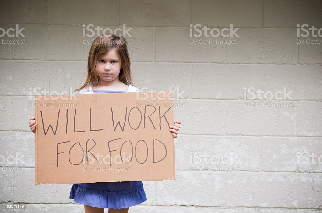 Little, Homeless Girl Holding Will Work For Food Sign royalty-free stock photo