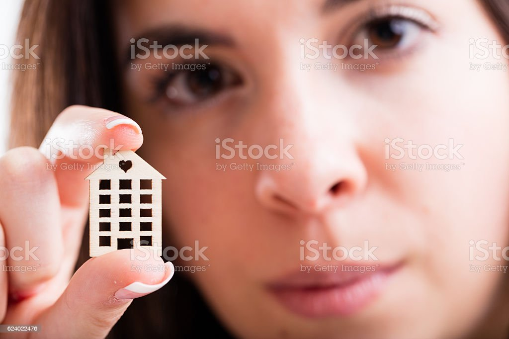 little house in foreground held by a woman stock photo