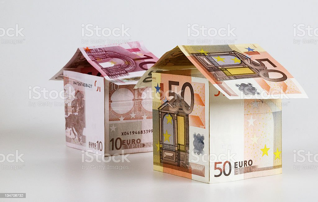 Little houses made from Euro paper currency stock photo
