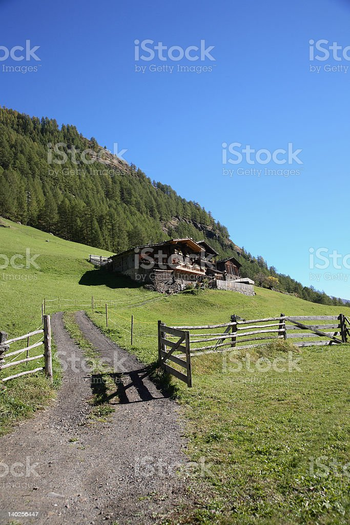 little hut in the alps stock photo