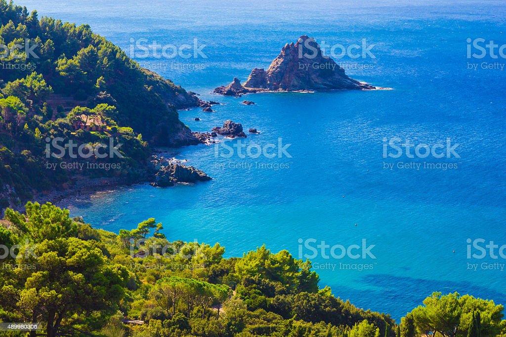 Little isle on blue sea stock photo