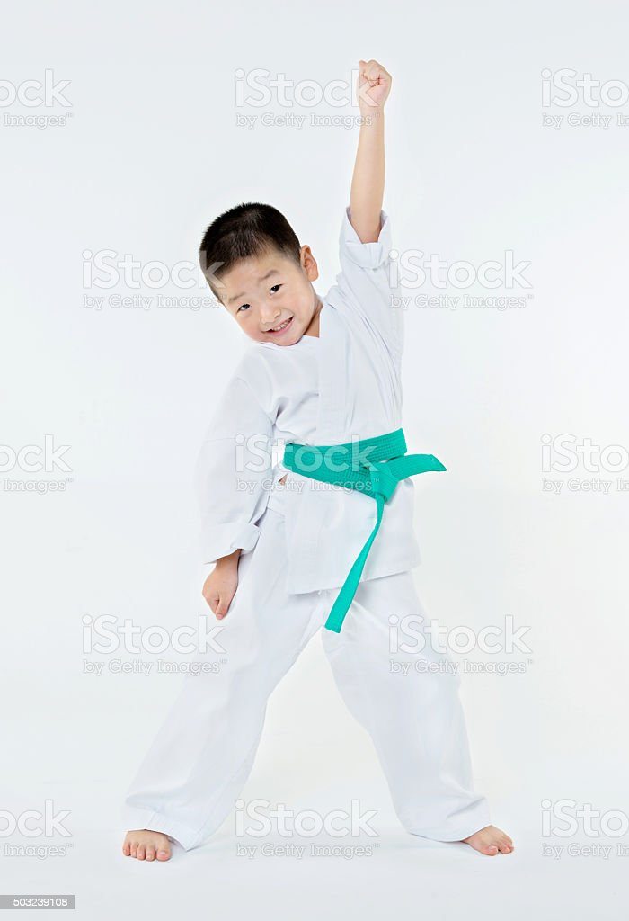 Little karate boy with hand up stock photo