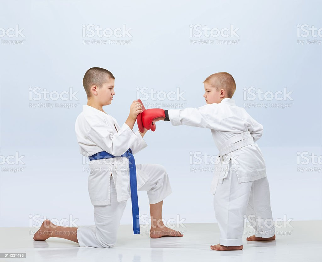 Little karateka beats punch on the simulator that brother keeps stock photo