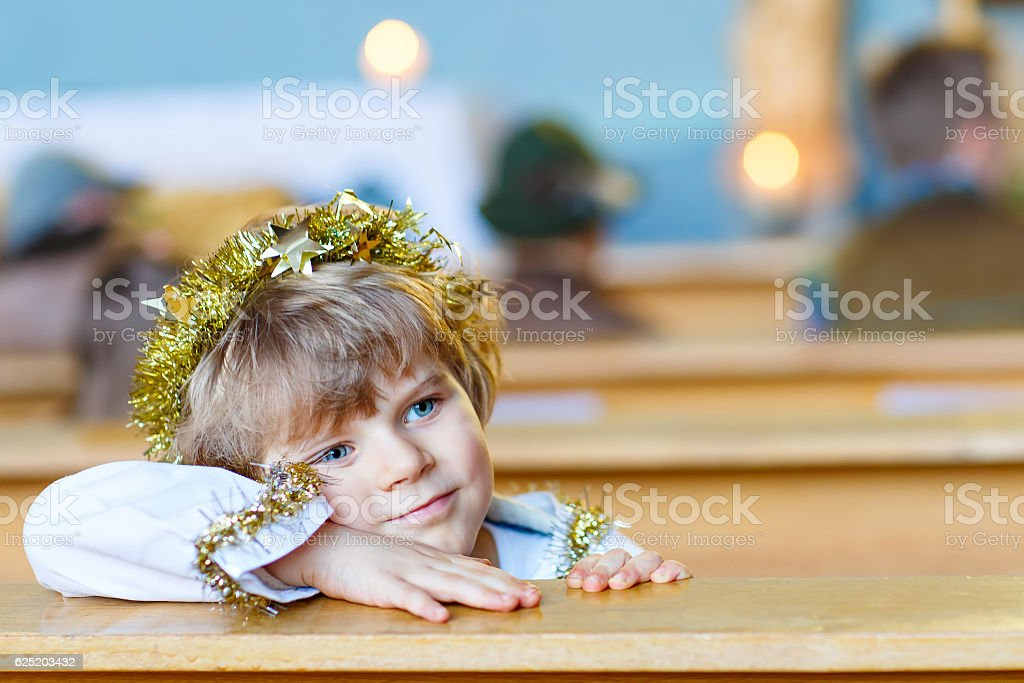 little kid boy in church on Christmas eve stock photo