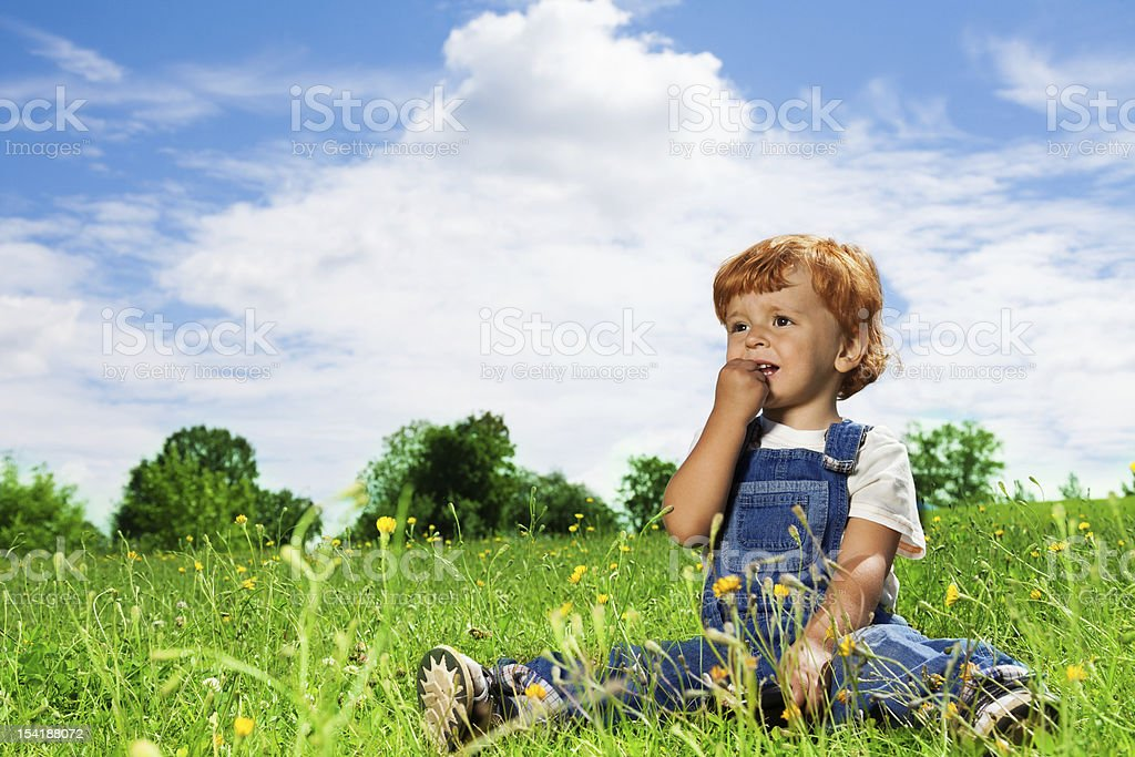 little kid eating snacks in the park royalty-free stock photo