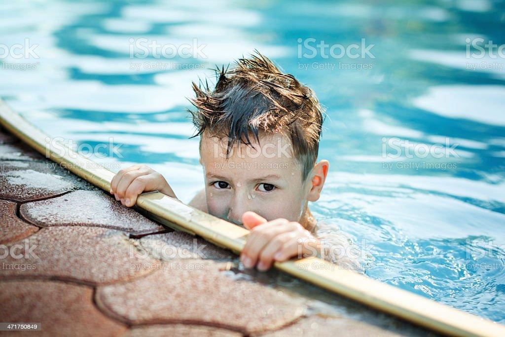 Little kid hide in pool royalty-free stock photo
