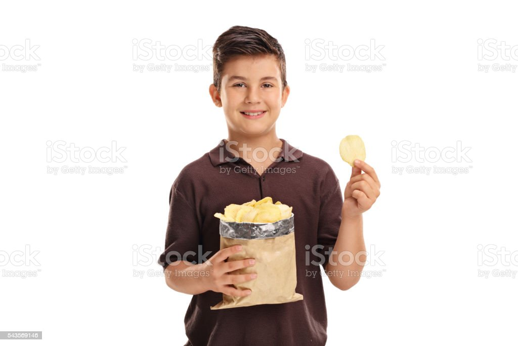 Little kid holding a bag of potato chips stock photo