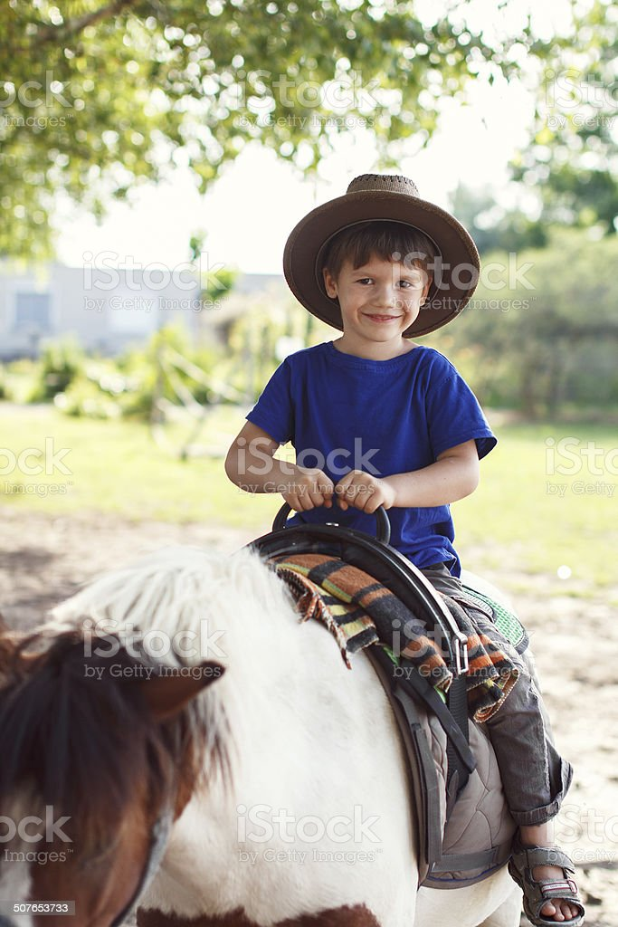 Little kid in hat on pony royalty-free stock photo