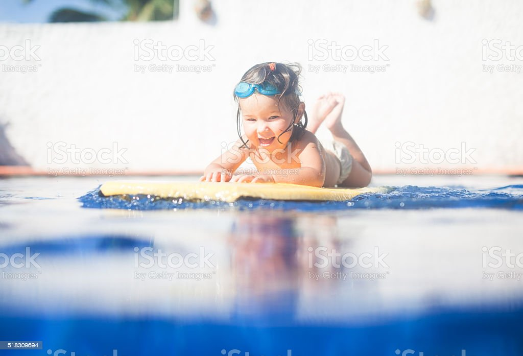 little kid in swimming pool stock photo