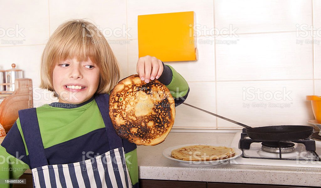 Little kid in the kitchen stock photo