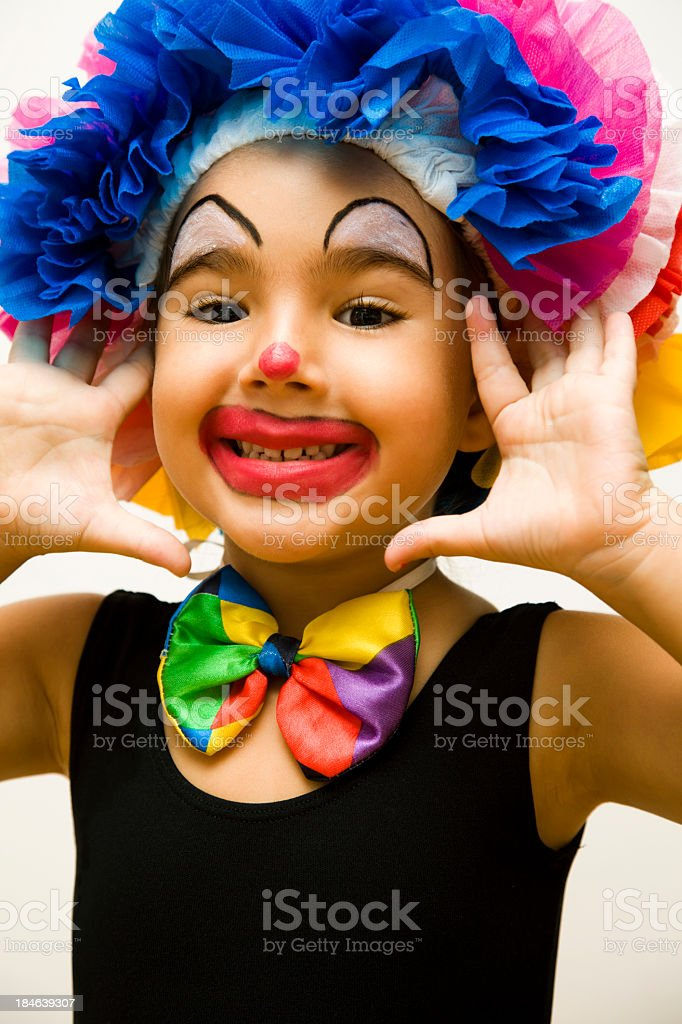 A little kid who is dressed up like a clown  royalty-free stock photo