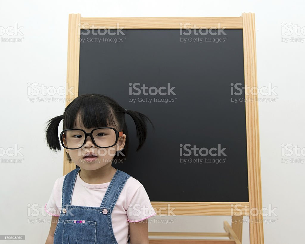 Little kid with blackboard royalty-free stock photo