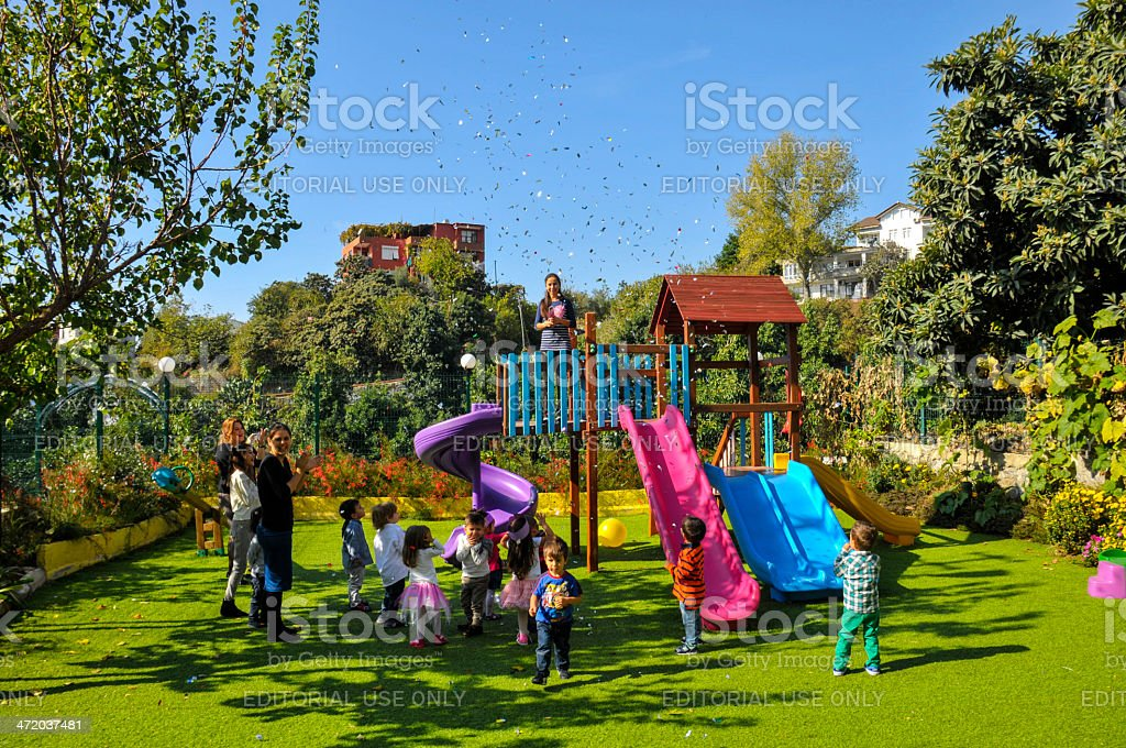 Little kids celebrating birthday stock photo