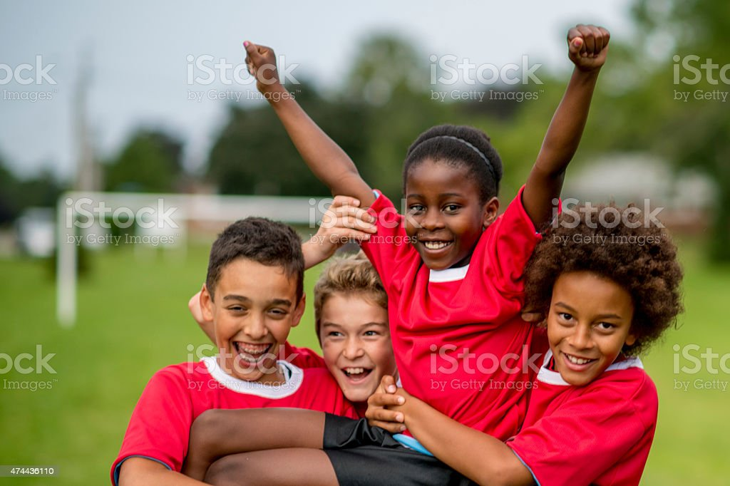 Little Kids Cheering in Victory stock photo
