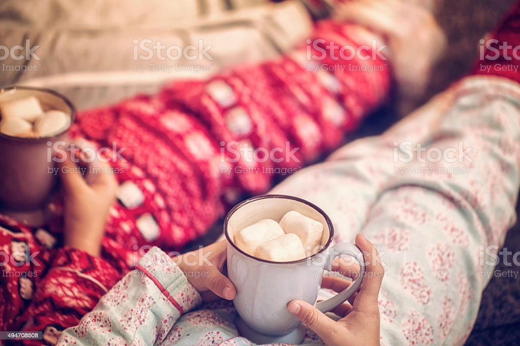 Little Kids Drinking Hot Chocolate for Christmas Time stock photo
