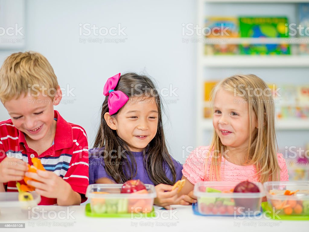 Little Kids Eating Lunch at School stock photo