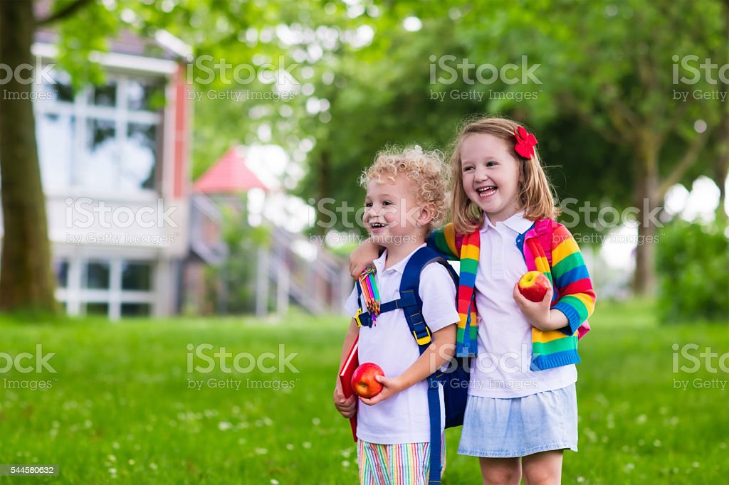 Little kids on first school day stock photo